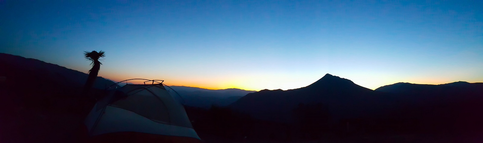 20150529_051126_Silhoutted tent sunrise panorama mile 616